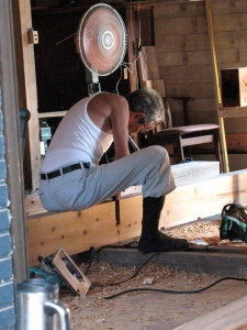 carpenter preparing a beam