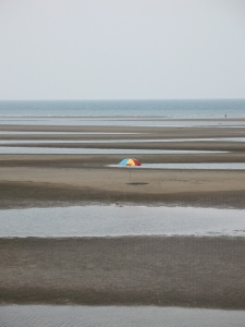 Matama Beach-lone umbrella on the tidal flat beach