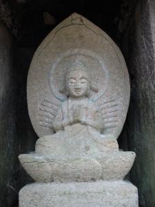 Stone carving on hillside behind Touzenji